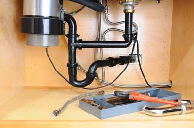Garburator being repaired in Vancouver by DJ Plumbing & Heating Service
