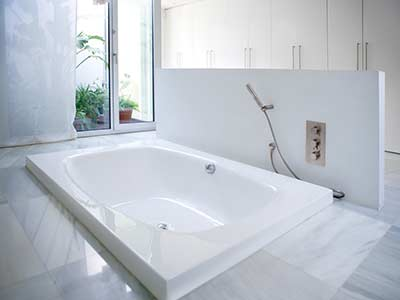 Bathroom remodeled with a fancy new bathtub.