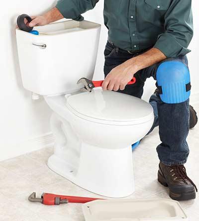 Vancouver plumber repair a toilet
